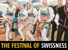 Men and women in traditional Swiss costumes at the Unspunnen festival.