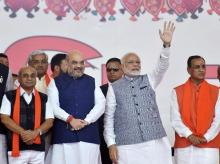 Prime Minister Narendra Modi, BJP President Amit Shah along with new CM Vijay Rupani and other state ministers during the swearing-in ceremony at Gandhinagar, Ahmedabad in Gujarat | File PTI Photo