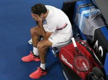 An emotional Roger Federer celebrates after winning the men's singles final at the Australian Open tennis championships in Melbourne. Photo: Reuters