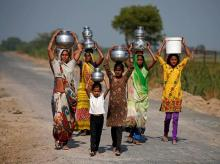Village women and girls carry water at Fangadi Village on the outskirts of Ahmedabad. Photo: Reuters.