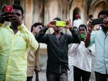 People using smartphone as camera