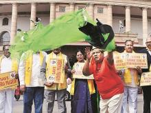 TDP MP Naramalli Sivaprasad and other party leaders stage a protest demanding special status for Andhra Pradesh outside Parliament in New Delhi on Friday. Photo: PTI