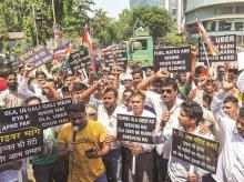 Cab drivers of Ola and Uber platforms protest for their demands in Mumbai. Photo: PTI