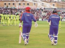 Brian Lara and Sachin Tendulkar stride out to bat for the International XI against Pakistan in an earthquake relief fund charity match in 2006. This columnist's World XI, however, has space only for Lara. File Photo: Reuters
