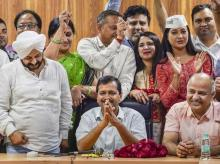 Delhi CM Arvind Kejriwal and Deputy CM Manish Sisodia with MLAs celebrating the judgment of  Delhi High Court at Kejriwal's residence in New Delhi