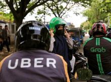 Uber, Grab