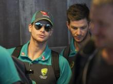 Australian cricket captain Steve Smith, left,  arrives with teammates, at the Cape Town International airport to depart to Johannesburg for the final five day cricket test match, in Cape Town, South Africa, Tuesday. File Photo: AP | PTI