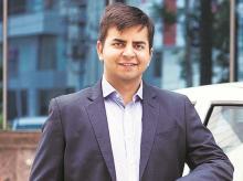 Ola, Softbank, electric vehicles, Japanese investor Softbank, Ola Mission Electric, Chinam Netaji Patro, Bhavish Aggarwal, CEO of Ola, Mahindra Electric, Bhavish Aggarwal