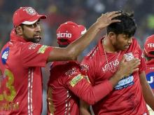 Kings XI Punjab's bowler Ankit Rajpoot celebrates with captain R Ashwin after taking wicket of Sunrisers Hyderabad's batsman Kane Williamson during an IPL T 20 cricket match in Hyderabad on Thursday. Photo: PTI