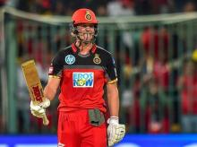 Royal Challengers Bangalore AB De Villiers celebrates his fifty runs during the IPL 2018 match against Chennai Super Kings at Chinnaswamy Stadium in Bengaluru on Wednesday.  Photo: PTI