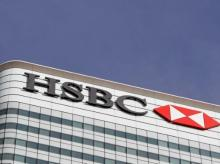 FILE PHOTO: The HSBC bank logo is seen at their offices in the Canary Wharf financial district in London, Britain | Photo: Reuters