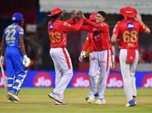 Kings XI Punjab team players celebrates wicket of Rajasthan Royals' Ajinkya Rahane during an IPL2018 cricket match at MPCA Holkar Stadium in Indore on Sunday | Photo: PTI