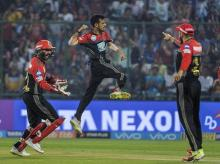 Royal Challengers Bangalore player Y Chahal exults after taking the wicket of Delhi Daredevils' Jason Roy during their IPL 2018 cricket match at Ferozshah Kotla. Photo: PTI