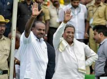 Karnataka Chief Minister H D Kumaraswamy with Karnataka former chief minister and Congress leader Siddaramaiah during the swearing-in ceremony of JD(S)-Congress coalition government