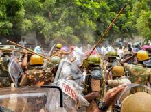 Police personnel baton charge at a protestor demanding the closure of Vedanta's Sterlite Copper unit, in Tuticorin