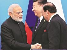 Pakistan's President Mamnoon Hussain (right) shakes hands with Prime Minister Narendra Modi at a signing ceremony during the Shanghai Cooperation Organisation summit at Qingdao in China on Sunday. Photo: Reuters