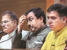Ram Madhav (centre), who is in charge of the BJP affairs in J&K, with Deputy CM Kavinder Gupta (first from left) and BJP state chief Ravinder Raina at a press conference in New Delhi on Tuesday. Photo: PTI
