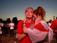 Supporters of England show empathy after the loss
