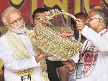 PM Narendra Modi and West Bengal BJP chief Dilip Ghosh