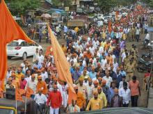 Protestors from the Maratha community take part in a rally demanding reservation, in Karad, Maharashtra on Tuesday. Photo: PTI
