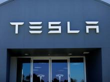 File photo: A Tesla sales and service center in Costa Mesa California