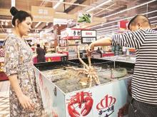 Taizhou Tianhe Aquatic Products' more than 1,000 workers process 10,000 tons a year of freshwater crayfish, frozen squid, dory fillets, and other seafood for sale to the US, Europe, and Australia