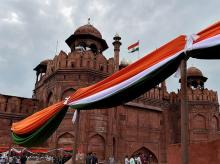 A cloth in the colours of the national flag is tied by the rampart of the Red Fort during the full dress rehearsal of the Independence Day function, in New Delhi