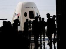 File photo: Members of the media gather around a replica of the Crew Dragon spacecraft at SpaceX headquarters in Hawthorne, California, US