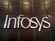 FILE PHOTO: The logo of Infosys is pictured inside the company's headquarters in Bengaluru | Photo: Reuters