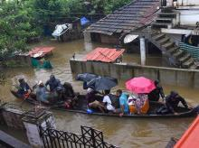 Kochi: Rescue officials assist villagers out of a flooded area, following heavy monsoon rainfall, near Kochi on Wednesday (Photo: PTI)