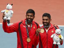Rohan Bopanna and D Sharan after winning Gold medal in Mens Tennis Doubles. Photo: Reuters
