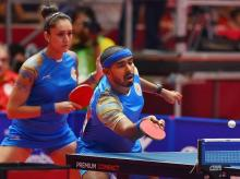 India's Achanta Sharath Kamal and Manika Batra in action during their quarter-final match against DPR Korea in Tablte Tennis Mixed Doubles. (Photo: PTI)