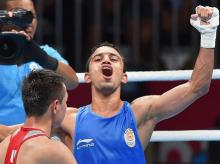 Jakarta: India's Amit Panghal (in blue) gestures after defeating Uzbekistan's Hasanboy Dusmatov during the Men's light fly (46-49kg) boxing final bout at the 18th Asian Games 2018 in Jakarta, Indonesia on Saturday, Sept 1, 2018. Photo: PTI