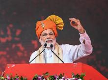 Prime Minister Narendra Modi addresses a public meeting during inauguration of Anand Agricultural University's Incubation Centre cum Centre of Excellence in Food Processing, in Anand, Gujarat