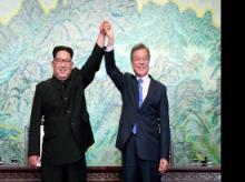 North Korean leader Kim Jong Un, left, South Korean President Moon Jae-in