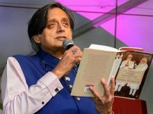 Congress MP Shashi Tharoor reads an excerpt from his latest book, The Paradoxical Prime Minister, during the 7th edition of 'Bangalore Literature Festival' (BLF), in Bengaluru on Sunday | Photo: PTI