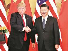 US President Donald Trump with Chinese counterpart Xi Jinping on the sidelines of the G20 summit | File Photo: Reuters