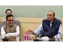 FM Arun Jaitley (right), in a farewell blog for Adhia, called him a highly competent, disciplined and no-nonsense civil servant of impeccable integrity | Photo: PTI