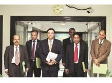 RBI Governor Urjit Patel (third from left) with Executive Director M D Patra, and deputy governors (from left) N S Vishwanathan, Mahesh Kumar Jain, B P Kanungo, and Viral Acharya after the fifth bi-monthly monetary policy meeting in Mumbai on Wednesd