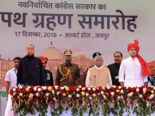Rajasthan Chief Minister Ashok Gehlot, Deputy Chief Minister Sachin Pilot and Governor Kalyan Singh stand for the national anthem after the swearing-in ceremony, at Albert Hall in Jaipur, Monday, Photo: PTI