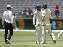 Virat Kohli looks to the umpire after he and opposing captain, Australia's Tim Paine came face to face after Kohli moved into Paine's path during play in the second cricket test between Australia and India in Perth | File Photo: AP/PTI