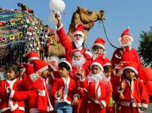 Children dressed as Santa Claus take part in Christmas celebration at a school in Ajmer