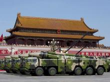 Chinese military vehicles carrying DF-21D anti-ship ballistic missiles, which are potentially capable of sinking a US Nimitz-class aircraft carrier in a single strike, travel past Tiananmen Gate during a military parade Photo: Reuters/File