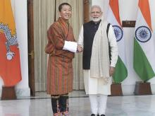 rime Minister Narendra Modi  shakes hands with his Bhutanese counterpart Lotay Tshering before their meeting at Hyderabad House, in New Delhi
