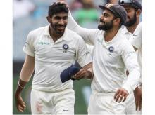 India's captain Virat Kohli, right, celebrates Jasprit Bumrah, left, after Bumrah got the wicket of Australia's Shaun Marsh during play on day three of the third cricket test between India and Australia in Melbourne | AP/PTI