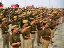 Police take oath with Ganga Jal in one hand ahead of their duty in Kumbh Mela 2019, in Allahabad