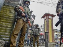 Security personnel stand guard at City Centre Lal Chowk in Srinagar, Friday | Photo: PTI