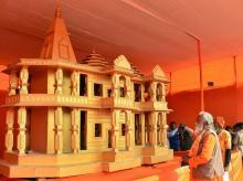 People look at a model of Ram Mandir, to be built in Ayodhya showcased at Kumbh Mela festival 2019, in Allahabad | Photo: PTI