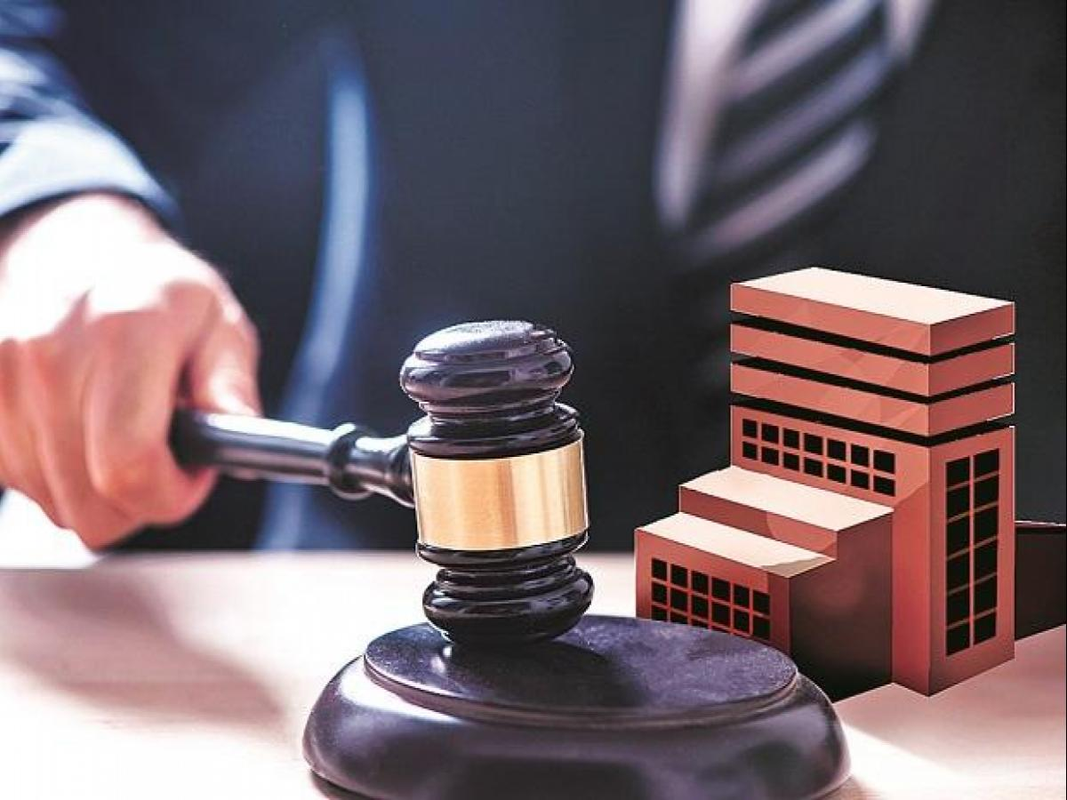 Realty firm under insolvency can continue to complete other projects: NCLAT  | Business Standard News