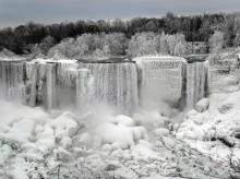 Water flows around ice, formed on the American Falls in Niagara Falls, New York, due to subzero temperatures